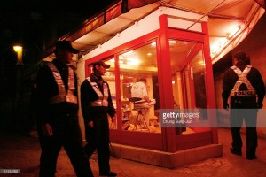 SEOUL, SOUTH KOREA - OCTOBER 23: South Korean police officers repress clandestine prostitution in a red-light district on October 23 2004 in Seoul, South Korea. 330,000 South Korean prostitutes did not work during one month up to today because of government's crackdown. The South Korean government began enforcing new laws last month to target human traffickers, pimps and prostitutes. The sex industry accounts for more than four percent of South Korea's gross domestic product (GDP), with its annual sales estimated at 24 trillion won (21 billion dollars) last year. Statistics show one in five South Korean men buy sex four times a month and 4.1 percent of women aged 20 to 30 rely on prostitution to make a living. (Photo by Chung Sung-Jun/Getty Images)